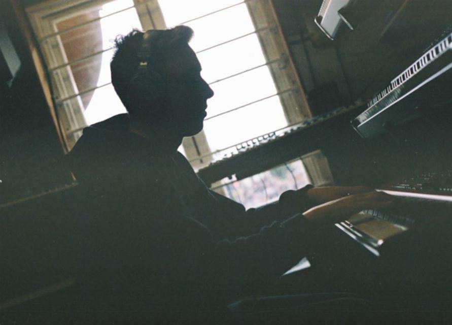 Film photo of Alastair McNamara playing piano